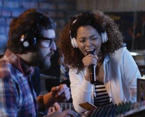 man and woman recording in an audio studio